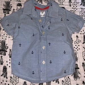 Light blue button-down polo